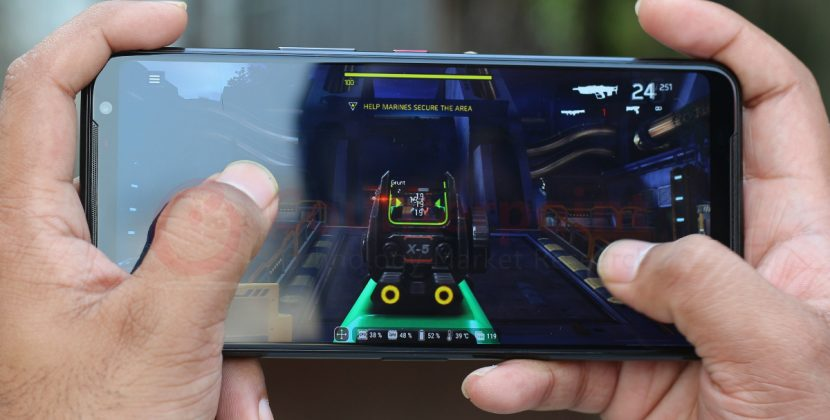 A hand holding phone and playing game in phone